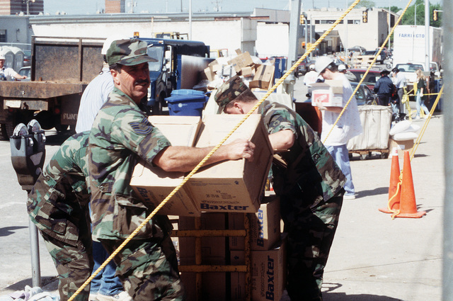 U.S. Air Force personnel from Tinker Air Force Base, Oklahoma, work to pass out bottles of water to rescue and support personnel at the explosion site of the Federal Building. The U.S. Air Force is providing around-the-clock support of personnel, equipment and supplies during rescue and relief efforts