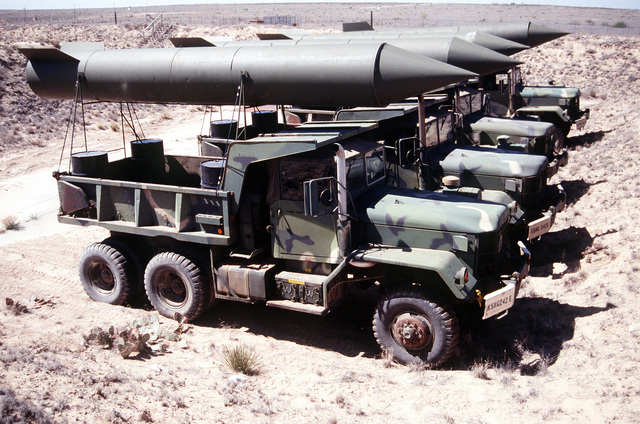 Look alike fake SCUD missile are mounted above 2 1/2 trucks at a site located near Roswell. The Dud Scuds are to be used in the annual air defense exercise as targets for the blue forces located at Fort Bliss, Texas