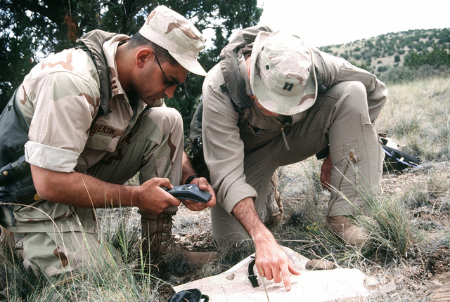 LT. Guertin and LT. Curly survivor from a simulated F-18 crash, use a map with the GPS (Global Positioning System) to find out their location in the state of New Mexico
