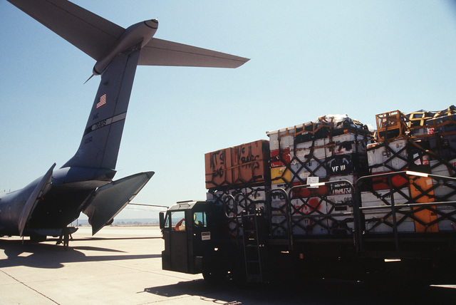 A C-141 from the 20th Airlift Squadron, 60th Air Mobility Wing, Travis Air Force Base, California is loaded with supplies and equipment at the Naval Air Station Miramar, before taking off for Roswell Air Force Base, New Mexico in support of the exercise