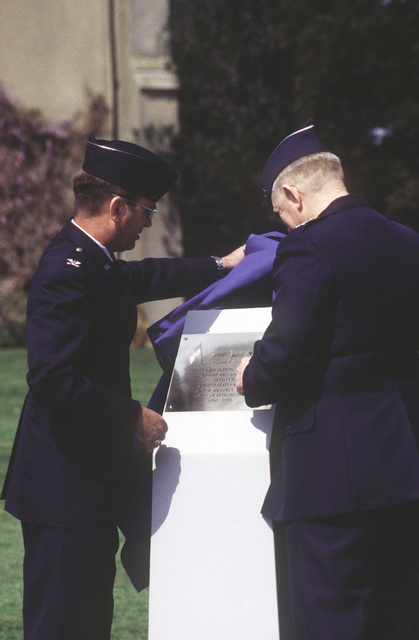 MAJ. GEN. James G. Andrus, Third Air Force Commander, helps the 774th Air Base Group's Commander, COL. Edward J. Atkins, unveil a commemorative plaque during the inactivation of the 774th ABG