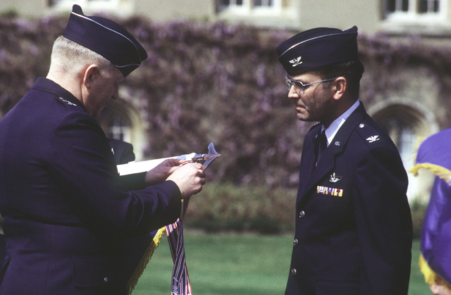 MAJ. GEN. James G. Andrus, Third Air Force Commander, presents the 774th Air Base Group, Outstanding Unit Award, as Base Commander COL. Edward J. Atkins looks proudly on