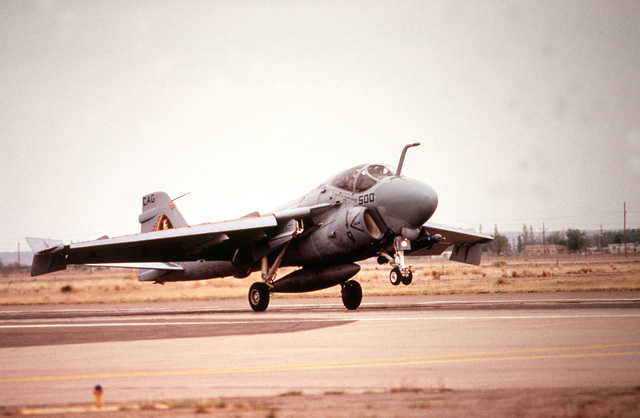 A 3/4 right front view of a US Navy A-6E Intruder lands at Roswell Industrial Air Center during the annual air defense exercise