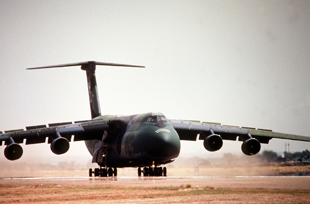 A 3/4 right side view of a US Air Force C-5 Galaxy from Travis Air Force Base, Calif., as it taxis down the ramp after landing at Roswell Industrial Air Center during the annual air defense exercise