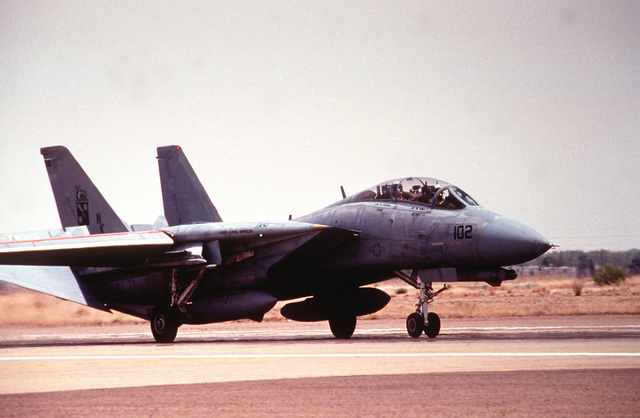 A right side view of a US Navy F-14D Tomcat from Fighter Squadron 11 (VF-11), Naval Air Station Miramar, Calif., taxis down the runway after landing at Roswell Industrial Air Center during the annual air defense exercise