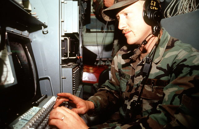 SENIOR AIRMAN Brian E. Smith, a technical controller from the 53rd Combat Communication Squadron, Robins Air Force Base, Ga., ensures communication equipment is on-line at Roswell Industrial Air Center during the annual air defense exercise