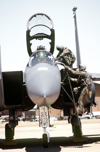 """Major Frank """"Zappa"""" De Martini an F-15 Strike Eagle pilot and Major Tom """"Bit"""" Bednarek a WSO (Weapons System Operator) both from the 334th FS Seymour Johnson AFB, NC, climb into the aircraft for another mission at Roswell Industrial Air Center"""