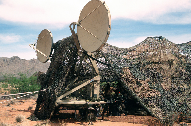 A close-up view of dual 9 1/2' tropo scatter microwave dishes. They are the quick reaction antenna for the TRC-170 Triple Scatter Microwave System that sends data to the Air Operations Center and Joint Forces Air Command