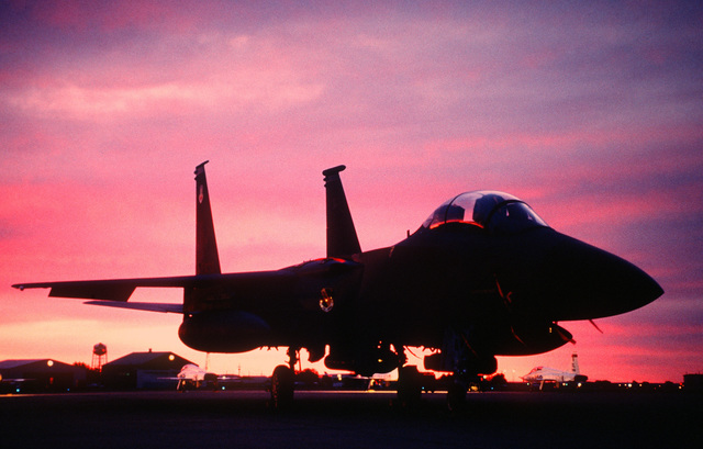 A US Air Force F-15E Strike Eagle from the 334th Fighter Squadron, Seymour Johnson Air Force Base, NC, sits on a ramp at sunrise during the annual air defense exercise