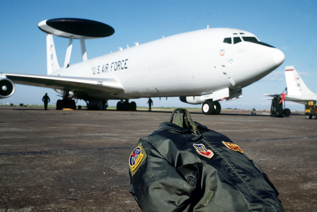 A flight bag and jacket wait to be loaded aboard an E-3 Sentry Airborne Warning and Control System (AWACS) aircraft. The aircraft is being prepared for a mission over Turkey in support of the operation. The operation is a security mission to enforce the United Nations no-fly zone north of the 36 degree parallel from Iraqi air and ground incursion. A four nation coalition of US, Turkey, Great Britain and France has been actively protecting and supplying Kurdish refugees since Desert Storm in 1991.(Exact date unknown)