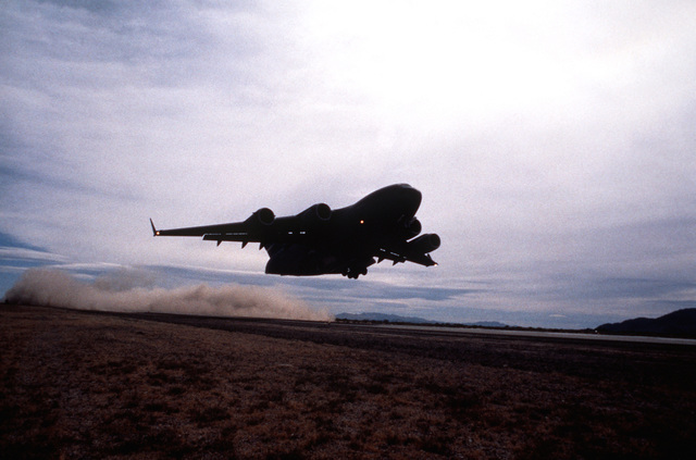 A U.S. Air Force C-17 Globemaster III takes off from a desert runway at the National Training Center. The exercise is designed to test the ability of the C-17 to support mission requirements and interface with the Army