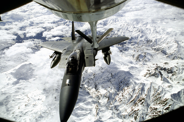 A US Air Force F-15 Eagle is refueled inflight for a mission over Iraq in support of the operation. This operation is a security mission to enforce the United Nations no-fly zone north of the 36 degree parallel from Iraqi air and ground incursion. A four nation coalition of US, Turkey, Great Britain and France has been actively protecting and supplying Kurdish refugees since Desert Storm in 1991.(Exact date unknown)