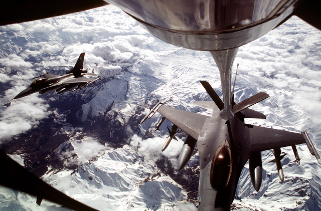 A US Air Force F-16 Fighting Falcon is refueled inflight as another F-16 waits in formation to be refueled for a mission over Iraq. This operation is a security mission to enforce the United Nations no-fly zone north of the 36 degree parallel from Iraqi air and ground incursion. A four nation coalition of US, Turkey, Great Britain and France has been actively protecting and supplying Kurdish refugees since Desert Storm in 1991.(Exact date unknown)