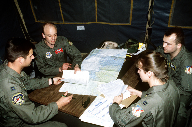 A US Air Force flight crew debriefs their flight after flying a mission over Turkey in support of the operation. This operation is a security mission to enforce the United Nations no-fly zone north of the 36 degree parallel from Iraqi air and ground incursion. A four nation coalition of US, Turkey, Great Britain and France has been actively protecting and supplying Kurdish refugees since Desert Storm in 1991.(Exact date unknown)