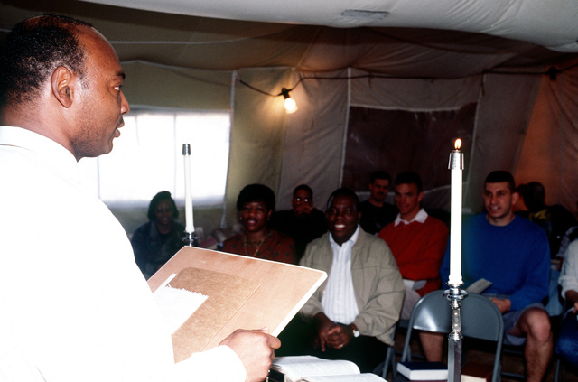 Chaplain (MAJ.) Reggie Cleveland gives the Sunday morning sermon at the tent city chapel. This operation is a security mission to enforce the United Nations no-fly zone north of the 36 degree parallel from Iraqi air and ground incursion. A four nation coalition of US, Turkey, Great Britain and France has been actively protecting and supplying Kurdish refugees since Desert Storm in 1991.(Exact date unknown)