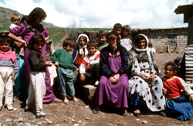 Kurdish women pose for photograph outside their home. This operation is a security mission to enforce the United Nations no-fly zone north of the 36 degree parallel from Iraqi air and ground incursion. A four nation coalition of US, Turkey, Great Britain and France has been actively protecting and supplying Kurdish refugees since Desert Storm in 1991.(Exact date unknown)