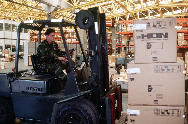 SENIOR AIRMAN Shawn Flynn uses a forklift to move a shipment of office furniture. Supplies for the operation are stored and shipped from this warehouse run by the 39th Supply Squadron. This operation is a security mission to enforce the United Nations no-fly zone north of the 36 degree parallel from Iraqi air and ground incursion. A four nation coalition of US, Turkey, Great Britain and France has been actively protecting and supplying Kurdish refugees since Desert Storm in 1991.(Exact date unknown)