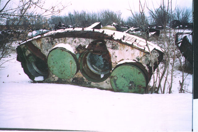 Ukraine - ICBM -SILO Dismantlement Project - Inspection team visit to unidentified ICBM  launch site. Photos of demolished ICBM SILOs, ICBM transportation, ICBM removal from SILO, various military vehicles