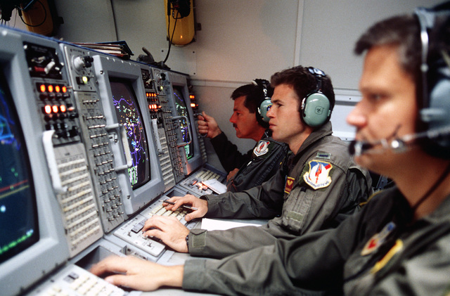 US Air Force weapons control officers onboard an E-3 Sentry Airborne Warning and Control System (AWACS) aircraft prepare for a mission over Turkey in support of the operation. This operation is a security mission to enforce the United Nations no-fly zone north of the 36 degree parallel from Iraqi air and ground incursion. A four nation coalition of US, Turkey, Great Britain and France has been actively protecting and supplying Kurdish refugees since Desert Storm in 1991.(Exact date unknown)