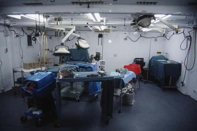 A field operating room of the 131st Field Hospital stands ready at the Oro Grande Range. The 131st is a multinational and multi-service unit providing health care at the Oro Grande base camp, or in the field units with rotating medical teams. Challenged by the desert environment and technical integration with a variety of United States and multinational services, personnel participate in the largest air defense exercise in the free world for ten days