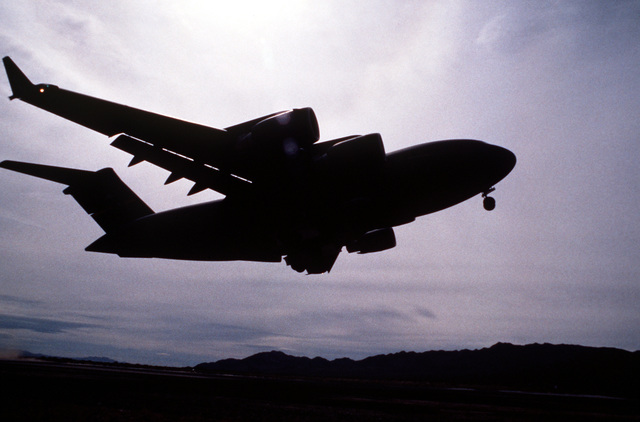 A U.S. Air Force C-17 Globemaster III takes off during a C-17 readiness review exercise. The exercise was designed to test the ability of the C-17 to support mission requirements and interface with the Army