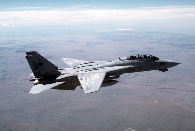 A side view of an F-14D Tomcat from the VF-31 Tomcatters as it flies a close air support mission over the desert
