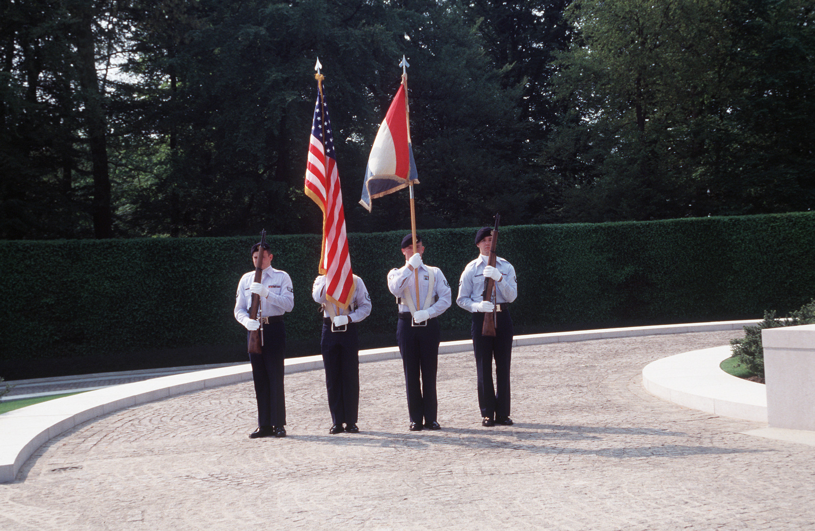 Members of the 86th Fighter Wing Honor Guard, Ramstein Air Base, Germany post the Colors at the Victory in Europe Day celebrations at Hamm Military Cemetery in Luxembourg