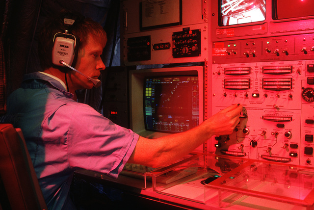 Dale Karr, Research and Development for the U.S. Army Airborne Surveillance Test Bed (AST) project, sits at the control panel of a Boeing 767, modified for Command Control Communications and equipped with an Infrared missile threat discrimination