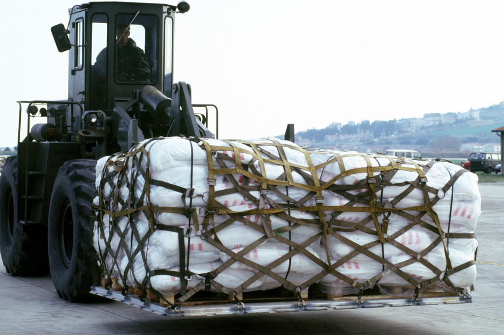 A forklift carrying a pallet of sacks of flour is driven to an awaiting U.S. Air Force C-130 Hercules. The flour will be flown on a humanitarian relief flight to Sarajevo. The United States is conducting three flights a day and each flight contains food, medicine and blankets to the war-torn nation of Bosnia-Herzegovina as part of the operation