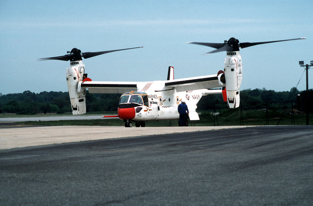 A left front view of the V-22 Osprey Tilt-rotor test aircraft revving up on the flightline at the Naval Air Station