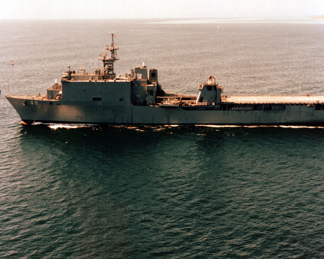 Aerial port beam view of the dock landing ship USS HARPERS FERRY (LSD-49) underway off the coast of San Diego
