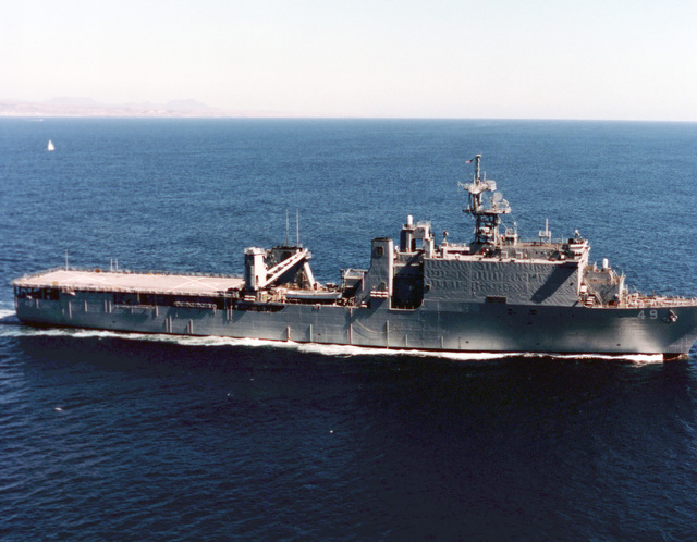 Low oblique starboard beam view of the dock landing ship USS HARPERS FERRY (LSD-49) underway off the coast of San Diego