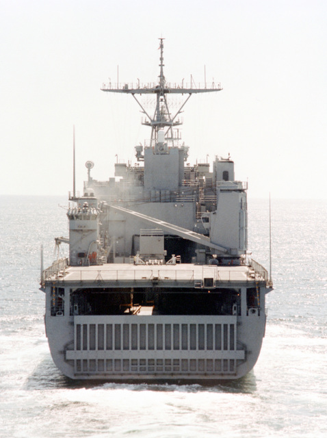Low oblique stern-on view of the dock landing ship USS HARPERS FERRY (LSD-49) underway off the coast of San Diego