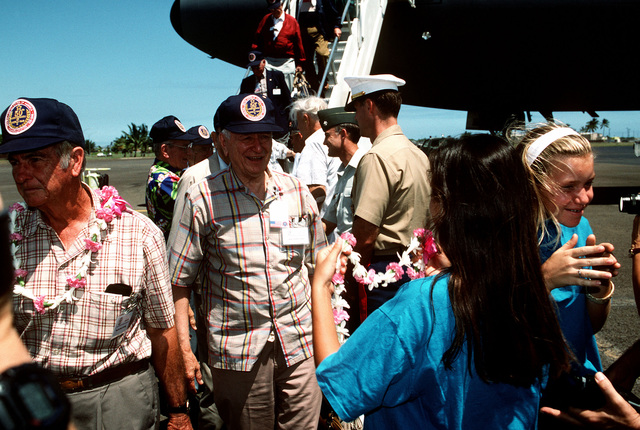 World War II China-Burma-India Veterans arrive on the first leg of their 32,000 mile journey of memories to commemorate the China-Burma-India Theater. The veterans arrived on a KC-10 from Travis AFB, CA and are greeted in Hawaii by local children who present each vet with an Hawaiian style laye. Pictured (left to right) MAJ. GEN. (USAF Ret) Eugene Sterling, COL. (USAF Ret) Joseph B. Shupe
