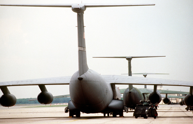 A rear view of C-141 Starlifters lined up on the flightline for deployment. The Starlifters will be used to airlift US Army soldiers and cargo to the training area near L'viv, Ukraine, for humanitarian and peacekeeping exercises