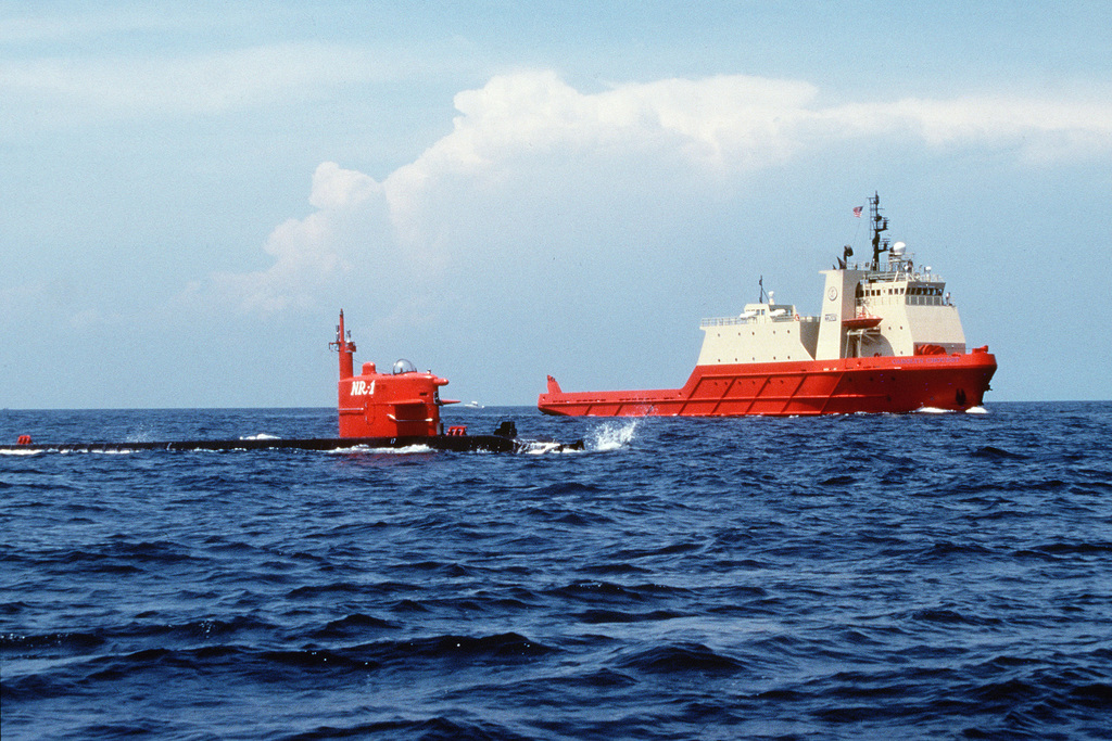 The Deep Submergence Rescue Vehicle (DSRV) support depot ship USNS Carolyn Chouest and the nuclear-powered deep submergence research craft NR-1 cruise through shallow waters off the coast of Key Largo prior to embarking on a new mission