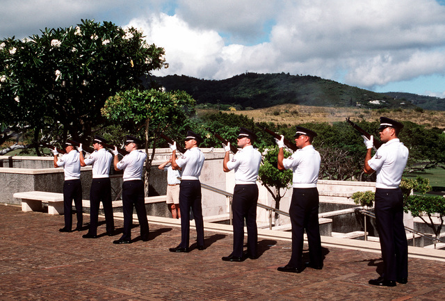 The Hickam Air Force Base Honor Guard commemorates the World War II China-Burma-India ceremony at the Punchbowl National Cemetery with a 21 gun salute