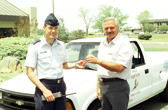 COL. James Donley, 9th Support Group commander, and Tom Johnson, 9th Services Squadron, received the keys to Beale's first alternatively fueled vehicle. The small pick-up truck motor was built by U.S. Electricar. According to Tom Johnson, the program coordinator, the U.S. government has mandated that 70 percent of all vehicles used by agencies be alternatively fueled vehicles