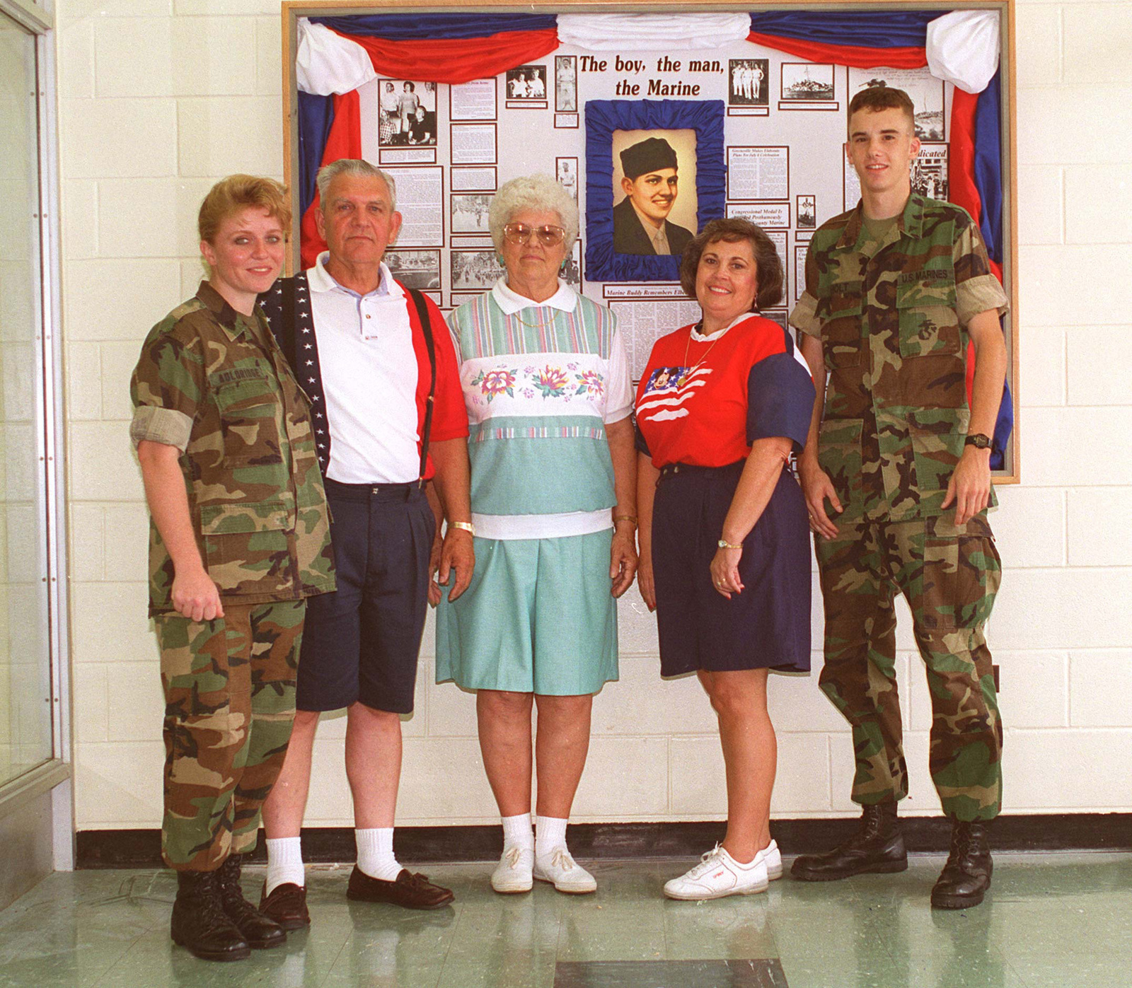SGT Zinda E. Auldridge, Mr. Charles F. Kinser, Mrs Hazel E. Kinser, Margaret M. Kinser, and LCPL Melvin F. Starcher, stand in front of the display board in Honor of the Medal Of Honor Recipient, SGT Elbert R. Kinser