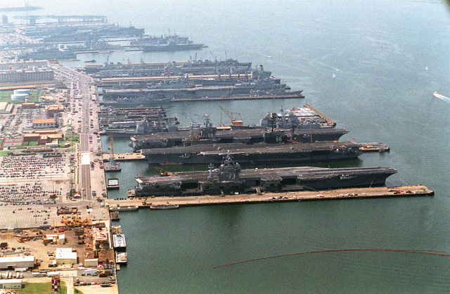 An aerial view of the Naval Station looking south-southeast. Identifiable are the nuclear-powered aircraft carrier USS DWIGHT D. EISENHOWER (CVN-69), USS AMERICA (CV-66) and the nuclear-powered USS GEORGE WASHINGTON (CVN-73)