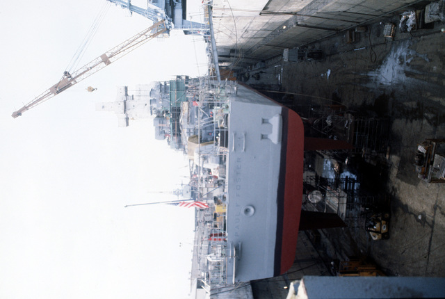 A stern view of the destroyer USS PAUL F. FOSTER (DD-964) undergoing a overhaul in drydock #3