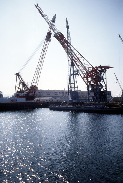 The largest crane at the Long Beach Naval Shipyard, the Titan II, is being dismantled for shipment to the Panama Canal Zone. The crane came to Long Beach from Germany at the end of World War Two as was reparation