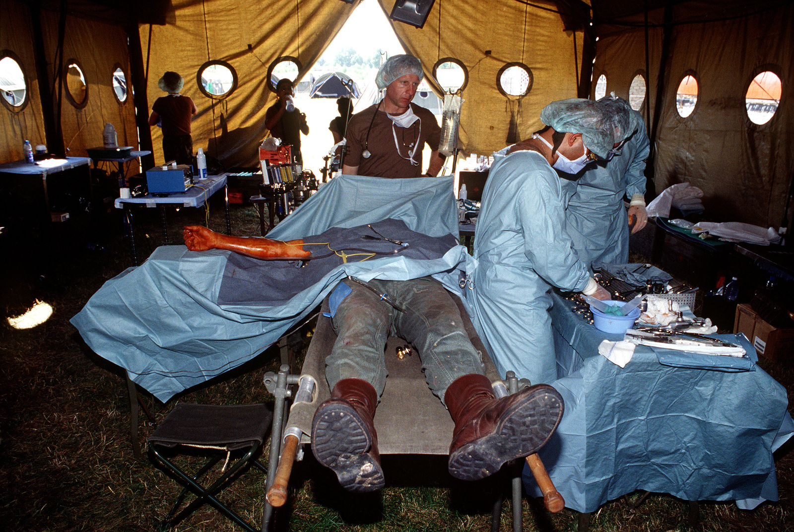 Members of the U.S. Air Force 52nd Medical Group, Spangdalem Air Base, Germany, perform mock surgery on a patient during a mass casualty exercise