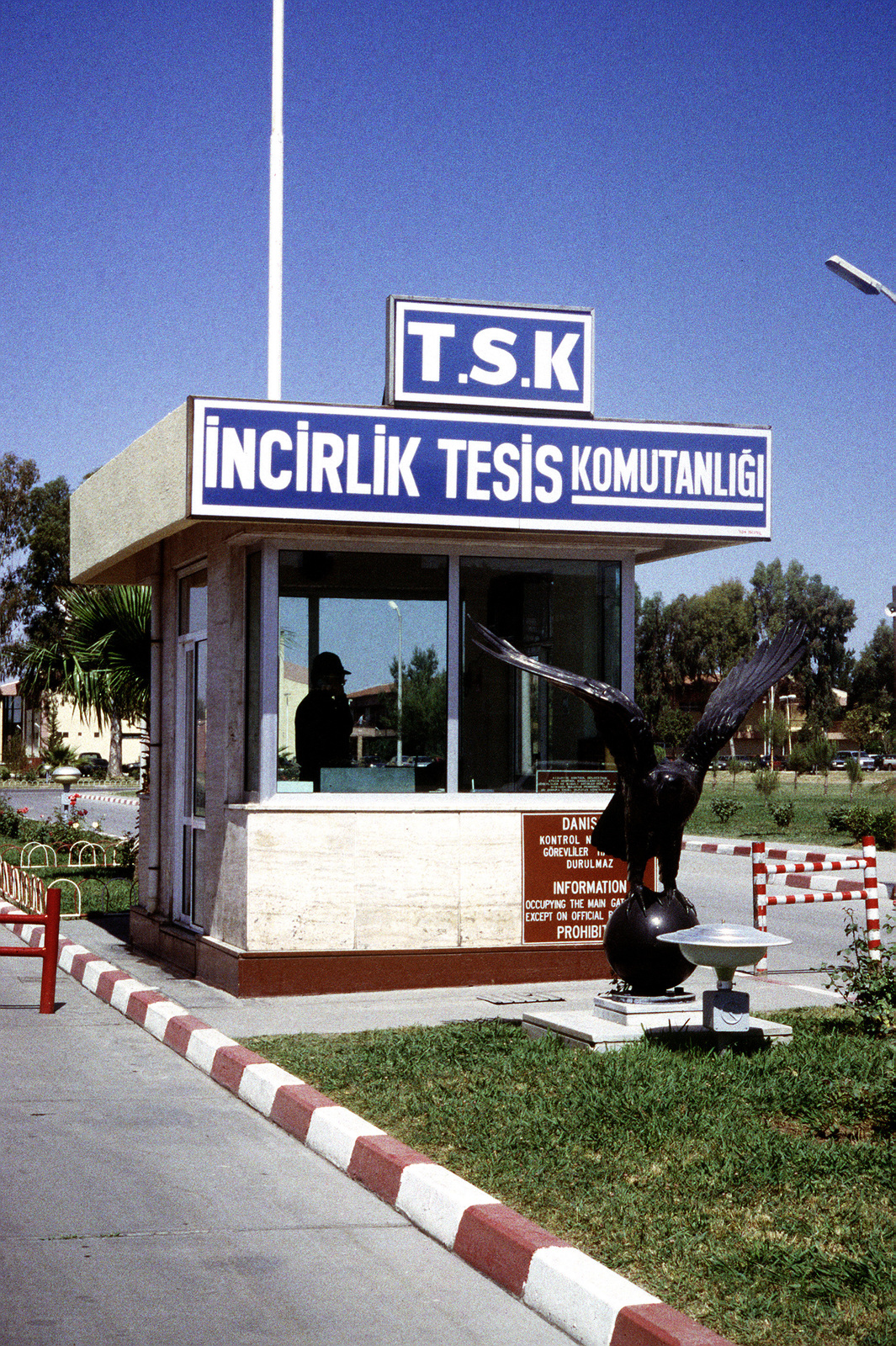 A close-up view of the main gate looking west. The gate is controlled and staffed by Turkish military. A U.S. Air Force Security Policeman serves on the gate as liaison