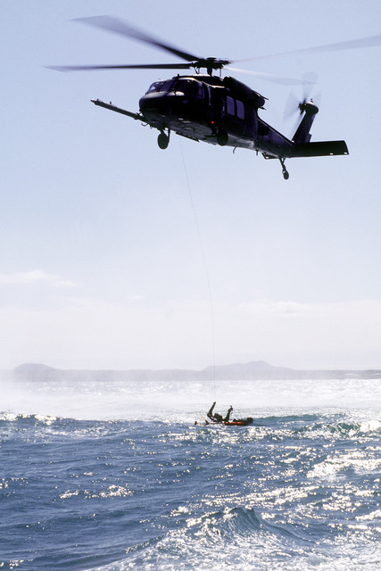 An HH-60G Pave Hawk from the 56th Rescue Squadron, Keflavik NAS, performs a rescue of a simulated downed airman off the coast of Iceland. During the rescue of the airman, a pararescueman jumps from the helicopter to help the survivor into the stretcher so he may be hoisted from the water. The simulated rescue is part of NORTHERN VIKING '95