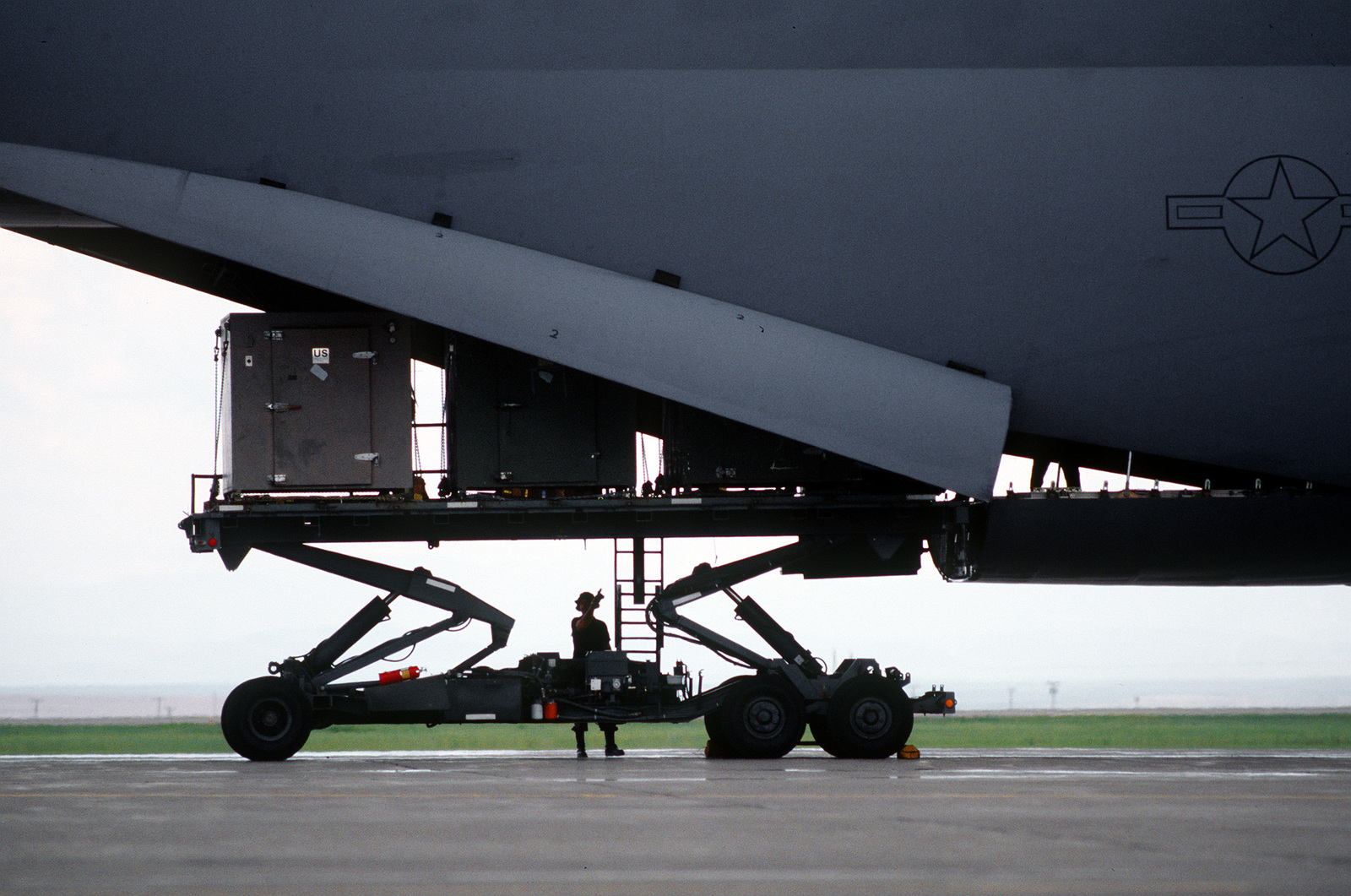 A 20,000 lb. capacity K-Loader loaded with pallets at the rear of the C-5B Galaxy from the 60th and 349th Air Mobility Wings, Travis Air Force Base, California. The equipment will be used by Air Force members who will practice their jobs with wartime scenarios and conditions during the Operational Readiness Inspection (ORI)
