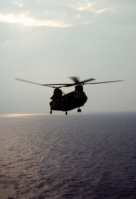 A US Army CH-47D Chinook helicopter from E Company, 502nd Aviation Regiment, Aviano, Italy, practices landings and take-offs from the deck of an amphibious assault ship as the ship operates off the coast of Italy