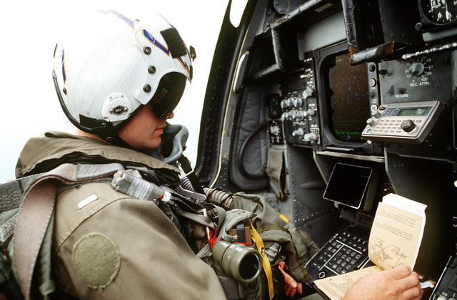 LT. J.D. McCreary, Electronic Countermeasure Officer, of VAQ-130 Zappers from Whidbey Island, WA (ECMO) sits at his station in a Navy EA-6B Prowler. The tasking of Suppression of Enemy Air Defenses (SEAD) involves protecting aircraft flying over Bosnia-Herzegovina with either their jamming capability or HARM (High-Speed Anti-Radiation missiles). Exact Date Shot Unknown