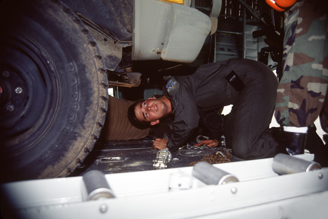 SENIOR AIRMAN Michael C. Randag, 815th Airlift Squadron, Keesler AFB checks to ensure the U.S. Army vehicles are secured inside the C-130 aircraft at the Kansas City Downtown Airport. The C-130 Hercules is from the Air Force Reserves 403rd Airlift Wing, 815th Squadron and its C-130s are participating in Exercise Patriot Express '95. The Army personnel will participate in operation Cooperate Nugget after they are airlifted to Fort Polk, La