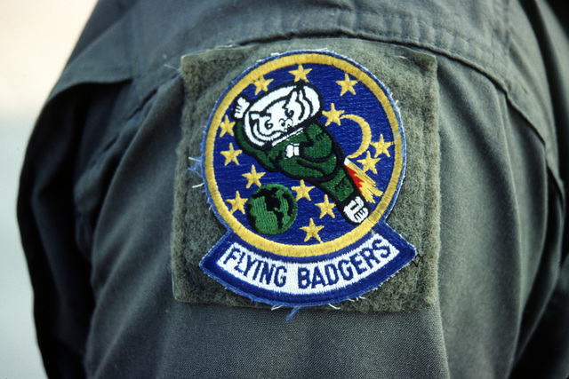 """The """"Flying Badgers"""" patch for the Air Force Reserves 95th Airlift Squadron, from the General Mitchell Milwaukee International Airport, Wisconsin, on the flight suit shoulder of a participant in Exercise Patriot Express '95"""